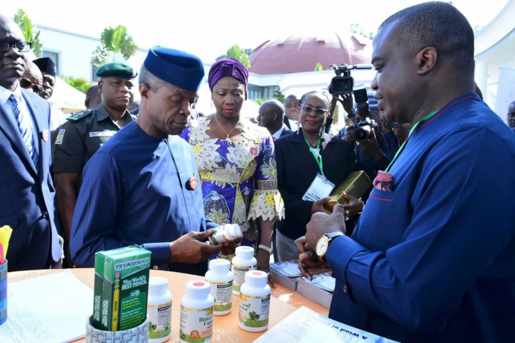 Vice President Yemi Osinbajo checking out Nature Herbal Life's bitter leaf product